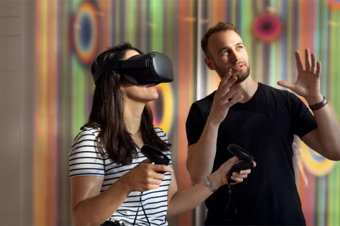 Two people using virtual reality glasses.